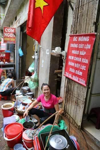 Vendeuse d'escargots bouillis